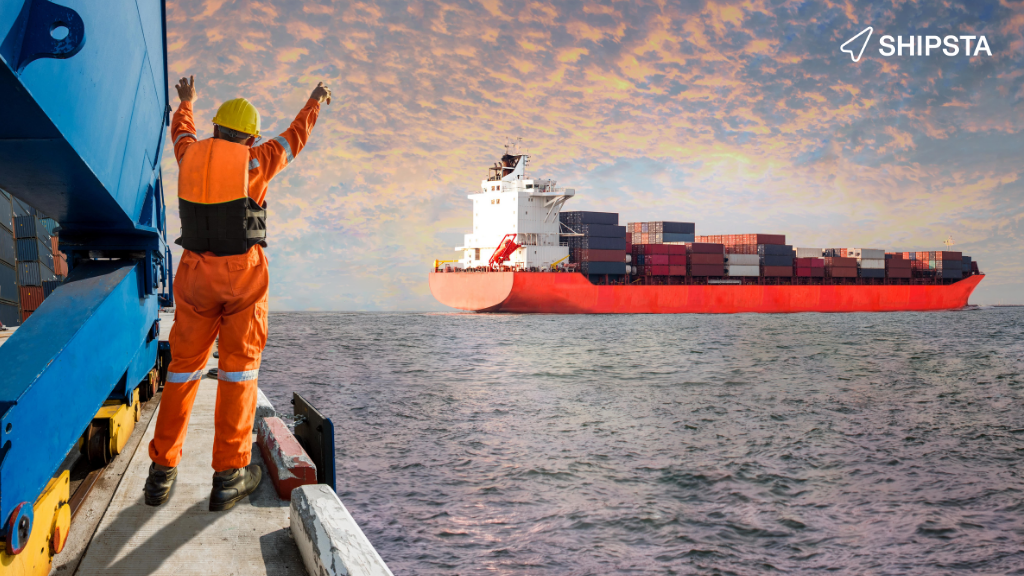 Man at dock celebrating a shipping container leaving port.
