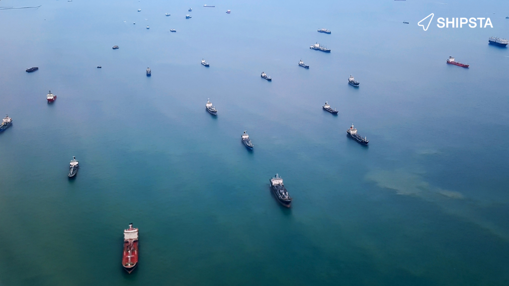 Lots of container ships sailing in a shipping lane